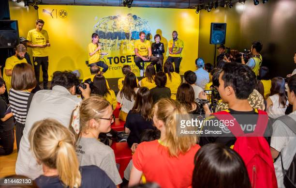 Goalkeeper Roman Weidenfeller of Borussia Dortmund and Oemer Toprak of Borussia Dortmund on stage during a meet and greet with fans in the Puma store...
