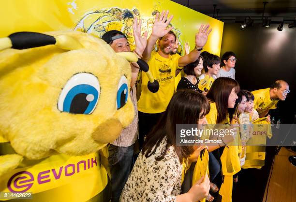 Goalkeeper Roman Weidenfeller of Borussia Dortmund and Oemer Toprak of Borussia Dortmund with fans during a meet and greet in the Puma store Harajuku...