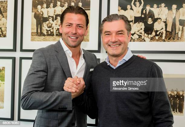 goalkeeper Roman Weidenfeller of Borussia Dortmund poses next to BVB sport director Michael Zorc after he extended his contract with the club until...