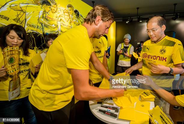 Goalkeeper Roman Weidenfeller of Borussia Dortmund with fans during a meet and greet in the Puma store Harajuku on July 14 2017 in Tokyo Japan