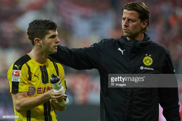 Goalkeeper Roman Weidenfeller of Dortmund and Christian Pulisic looks dejected during the Bundesliga match between Bayern Muenchen and Borussia...