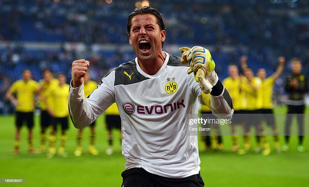 Goalkeeper <a gi-track='captionPersonalityLinkClicked' href=/galleries/search?phrase=Roman+Weidenfeller&family=editorial&specificpeople=726753 ng-click='$event.stopPropagation()'>Roman Weidenfeller</a> of Dortmund celebrates after winning the Bundesliga match between FC Schalke 04 and Borussia Dortmund at Veltins-Arena on October 26, 2013 in Gelsenkirchen, Germany.