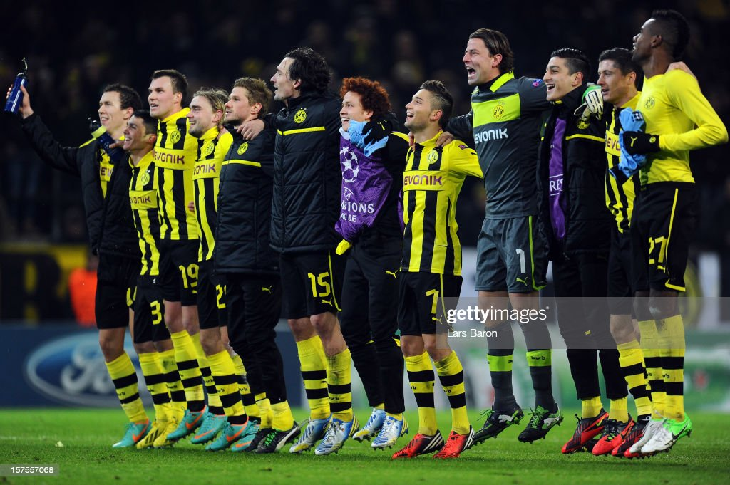 Goalkeeper <a gi-track='captionPersonalityLinkClicked' href=/galleries/search?phrase=Roman+Weidenfeller&family=editorial&specificpeople=726753 ng-click='$event.stopPropagation()'>Roman Weidenfeller</a> of Dortmund (#1) celebrates with team mates after winning the UEFA Champions League group D match between Borussia Dortmund and Manchester City at Signal Iduna Park on December 4, 2012 in Dortmund, Germany.