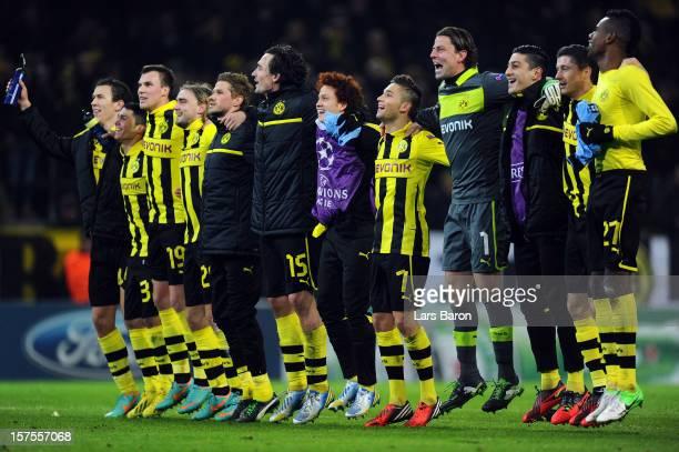 Goalkeeper Roman Weidenfeller of Dortmund celebrates with team mates after winning the UEFA Champions League group D match between Borussia Dortmund...