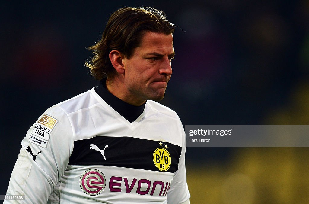 Goalkeeper <a gi-track='captionPersonalityLinkClicked' href=/galleries/search?phrase=Roman+Weidenfeller&family=editorial&specificpeople=726753 ng-click='$event.stopPropagation()'>Roman Weidenfeller</a> of Dortmund looks dejected during the Bundesliga match between Borussia Dortmund and Hamburger SV at Signal Iduna Park on February 9, 2013 in Dortmund, Germany.