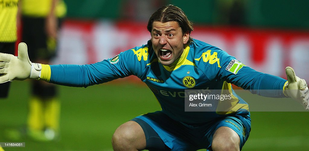 Goalkeeper <a gi-track='captionPersonalityLinkClicked' href=/galleries/search?phrase=Roman+Weidenfeller&family=editorial&specificpeople=726753 ng-click='$event.stopPropagation()'>Roman Weidenfeller</a> of Dortmund reacts during the DFB Cup semi final match between SpVgg Greuther Fuerth and Borussia Dortmund at Trolli-Arena on March 20, 2012 in Fuerth, Germany.