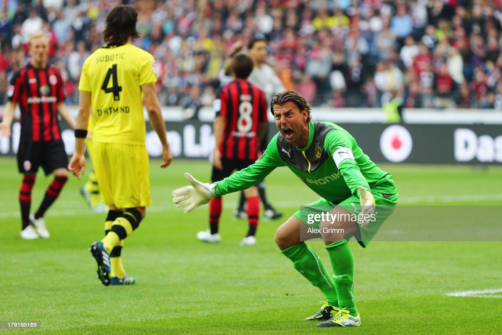 Goalkeeper <a gi-track='captionPersonalityLinkClicked' href=/galleries/search?phrase=Roman+Weidenfeller&family=editorial&specificpeople=726753 ng-click='$event.stopPropagation()'>Roman Weidenfeller</a> of Dortmund reacts during the Bundesliga match between Eintracht Frankfurt and Borussia Dortmund at Commerzbank Arena on September 1, 2013 in Frankfurt am Main, Germany.