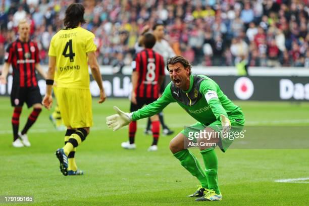 Goalkeeper Roman Weidenfeller of Dortmund reacts during the Bundesliga match between Eintracht Frankfurt and Borussia Dortmund at Commerzbank Arena...