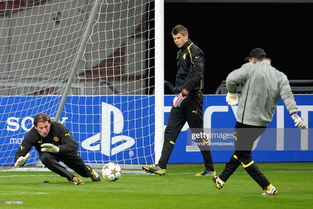 Goalkeeper <a gi-track='captionPersonalityLinkClicked' href=/galleries/search?phrase=Roman+Weidenfeller&family=editorial&specificpeople=726753 ng-click='$event.stopPropagation()'>Roman Weidenfeller</a> of Dortmund takes part in a training session ahead of the UEFA Champions League match against Ajax Amsterdam on November 20, 2012 in Amsterdam, Netherlands.