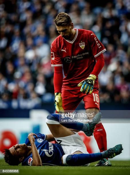 Goalkeeper Ron Robert Zieler of Stuttgart helps Armine Harit of Schalke during the Bundesliga match between FC Schalke 04 and VfB Stuttgart at...