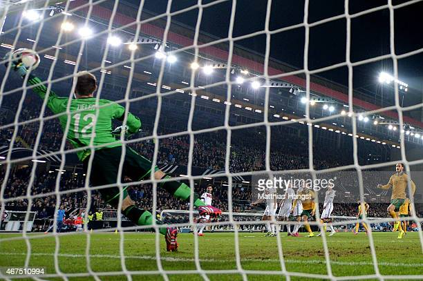 Goalkeeper RonRobert Zieler of Germany dives in vain as Mile Jedinak of Australia scores his team's second goal from a free kick during the...