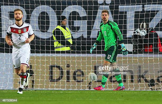 Goalkeeper RonRobert Zieler of Germany looks dejected as Mile Jedinak of Australia scores their second goal from a free kick during the international...