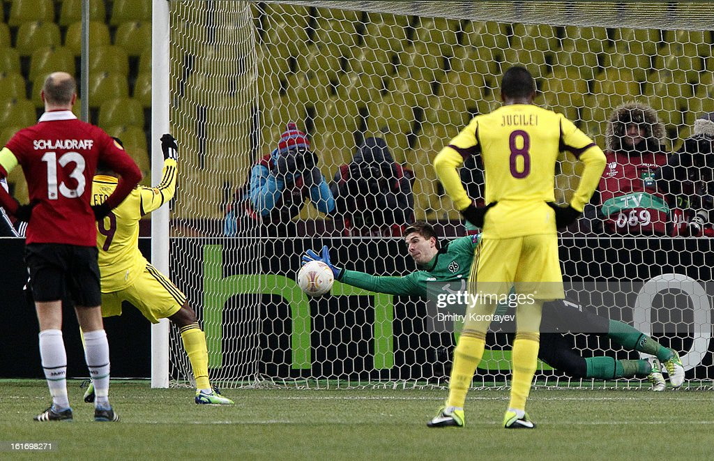 Goalkeeper <a gi-track='captionPersonalityLinkClicked' href=/galleries/search?phrase=Ron-Robert+Zieler&family=editorial&specificpeople=727037 ng-click='$event.stopPropagation()'>Ron-Robert Zieler</a> of Hannover 96 makes a save during the UEFA Europa League Round of 32 first leg match between FC Anji Makhachkala and Hannover 96 at the Luzhniki Stadium on February 14, 2013 in Moscow, Russia.
