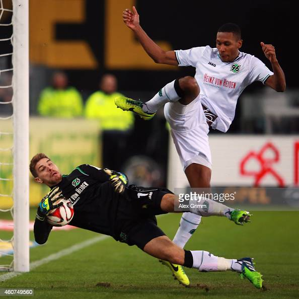 Goalkeeper RonRobert Zieler of Hannover makes a save ahead of team mate Marcelo during the Bundesliga match between SC Freiburg and Hannover 96 at...