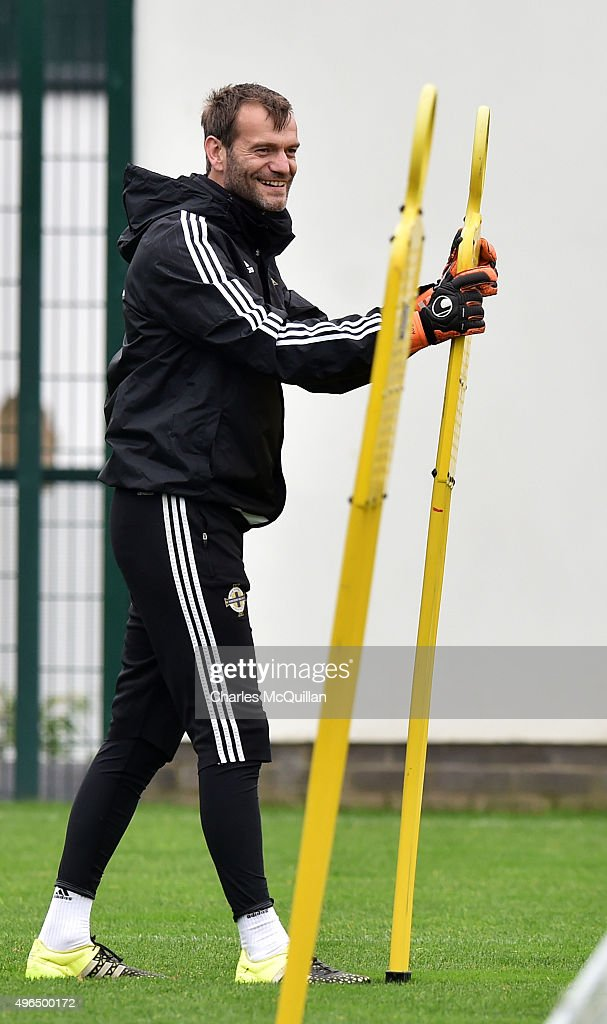 Goalkeeper <a gi-track='captionPersonalityLinkClicked' href=/galleries/search?phrase=Roy+Carroll&family=editorial&specificpeople=206286 ng-click='$event.stopPropagation()'>Roy Carroll</a> takes part in a drill as the Northern Ireland international football squad hold a training session at Queens University Sports Ground on November 10, 2015 in Belfast, Northern Ireland. Northern Ireland play Latvia in an international friendly game at Windsor Park on Friday evening.