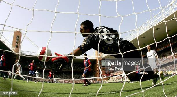 Goalkeeper Rubens Fernando Rubinho of Genoa fails to save the goal scored by Massimo Ambrosini of AC Milan during the Serie A match between Genoa and...
