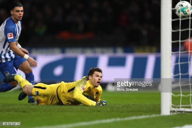 Goalkeeper Rune Jarstein of Berlin can't safe a shot by Lars Stindl of Moenchengladbach who scored his teams first goal to make it 01 during the...