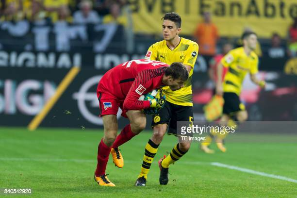 Goalkeeper Rune Jarstein of Hertha BSC Berlin and Marc Bartra of Dortmund battle for the ball during the Bundesliga match between Borussia Dortmund...