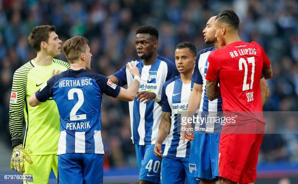 Goalkeeper Rune Jarstein of Hertha BSC reacts with John Anthony Brooks of Hertha BSC during the Bundesliga match between Hertha BSC and RB Leipzig at...