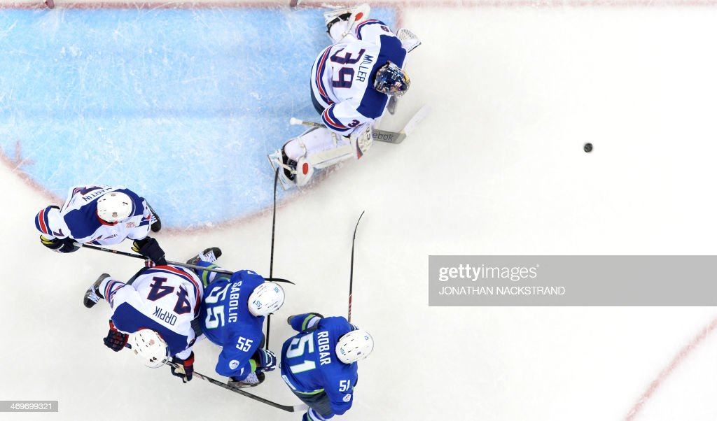 US goalkeeper Ryan Miller blocks the goal during the Men's Ice Hockey Group A match between Slovenia and USA at the Shayba Arena during the Sochi Winter Olympics on February 16, 2014.