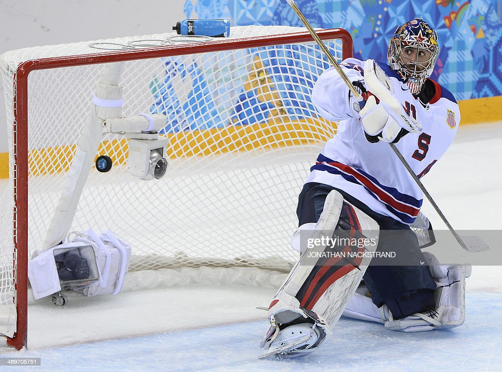 US goalkeeper Ryan Miller reacts as the puck flies past him into his goal after a shot of Slovenia's Marcel Rodman (unseen) during the Men's Ice Hockey Group A match between Slovenia and USA at the Shayba Arena during the Sochi Winter Olympics on February 16, 2014.