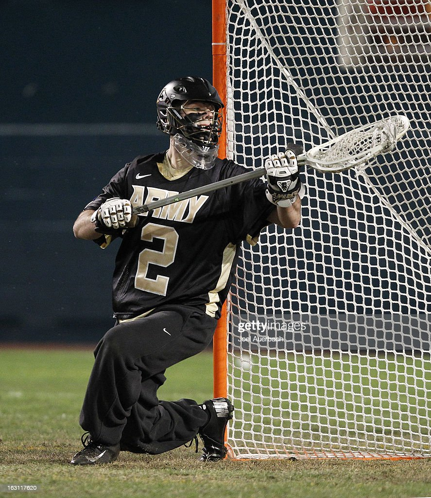 Goalkeeper Sam Somers #2 of the Army Black Knights stops a shot by the Michigan Wolverines during the 2013 Orange Bowl Lacrosse Classic on March 2, 2013 at SunLife Stadium in Miami Gardens, Florida. Army defeated Michigan 12-1.