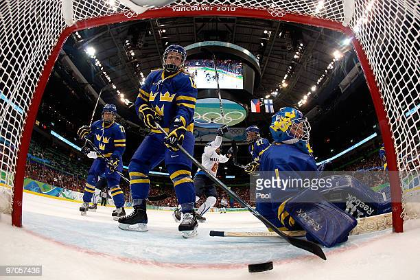 Goalkeeper Sara Grahn of Sweden concedes a goal to Michelle Karvinen of Finland during the ice hockey women's bronze medal game between Finland and...