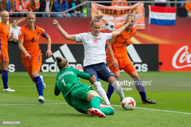 Goalkeeper Sari van Veenendaal of the Netherlands and Caroline Graham Hansen of Norway battle for the ball during their Group A match between...