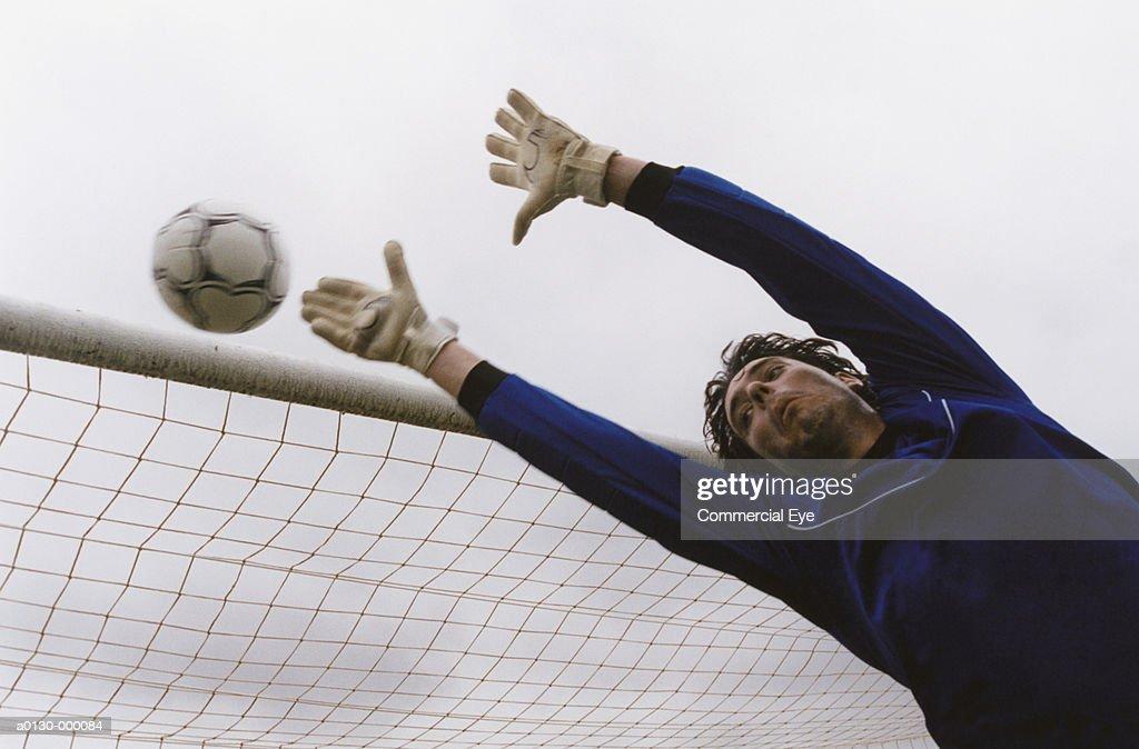 Goalkeeper Saves Shot : Stock Photo