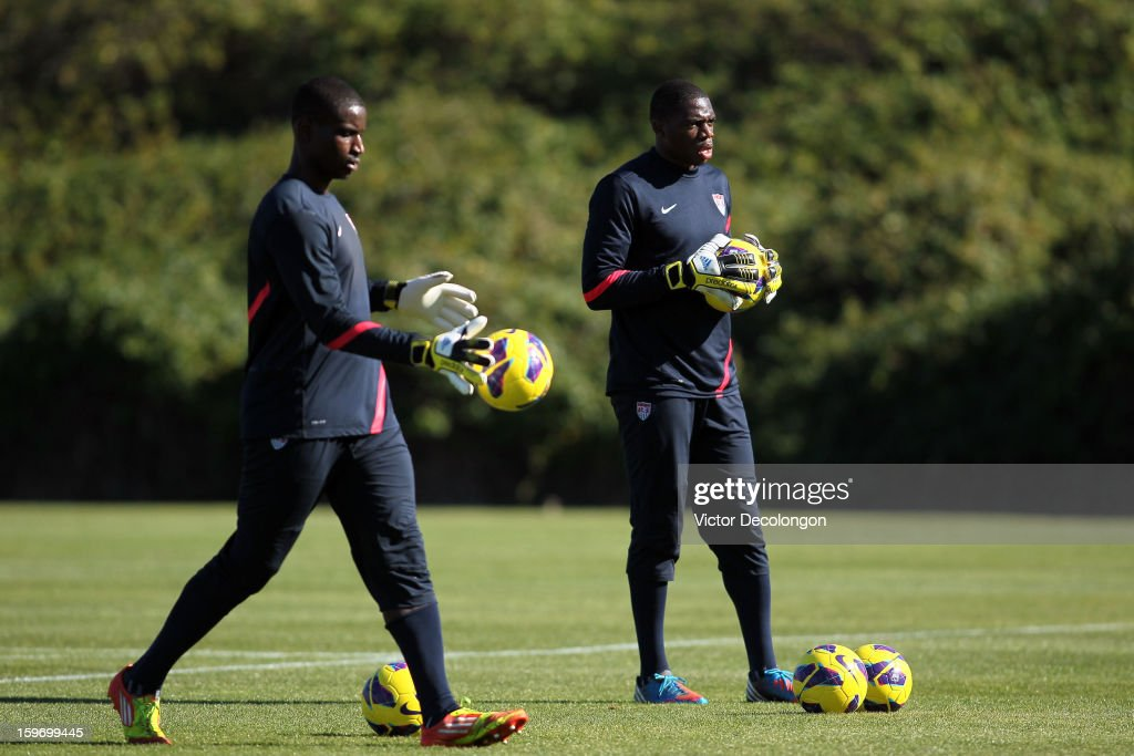 Goalkeeper Sean Johnson as fellow keeper Bill Hamid kicks the ball during the U.S. Men's Soccer Team training session at the Home Depot Center on January 17, 2013 in Carson, California.