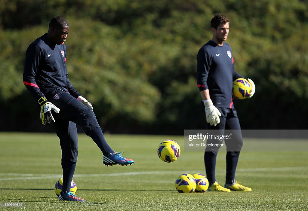 Goalkeeper Sean Johnson kicks the ball during a drill as fellow keeper Tally Hall looks on during the U.S. Men's Soccer Team training session at the Home Depot Center on January 17, 2013 in Carson, California.