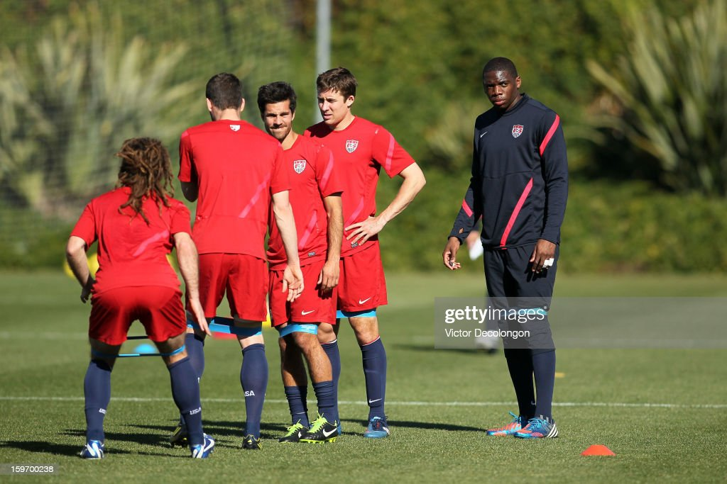 Goalkeeper Sean Johnson, Matt Besler and Benny Feilhaber wait their turn to do a stretch drill during the U.S. Men's Soccer Team training session at the Home Depot Center on January 17, 2013 in Carson, California.