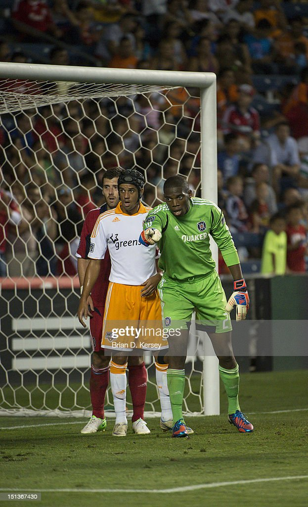 Goalkeeper Sean Johnson of Chicago Fire points as teammate Gonzalo Segares Calen Carr of Houston Dynamo line up for a corner kick and at Toyota Park...