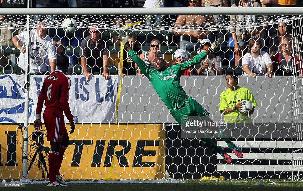 Goalkeeper Sean Johnson of the Chicago Fire can't make the save on a shot by Mike Magee of the Los Angeles Galaxy for a goal in the second half...