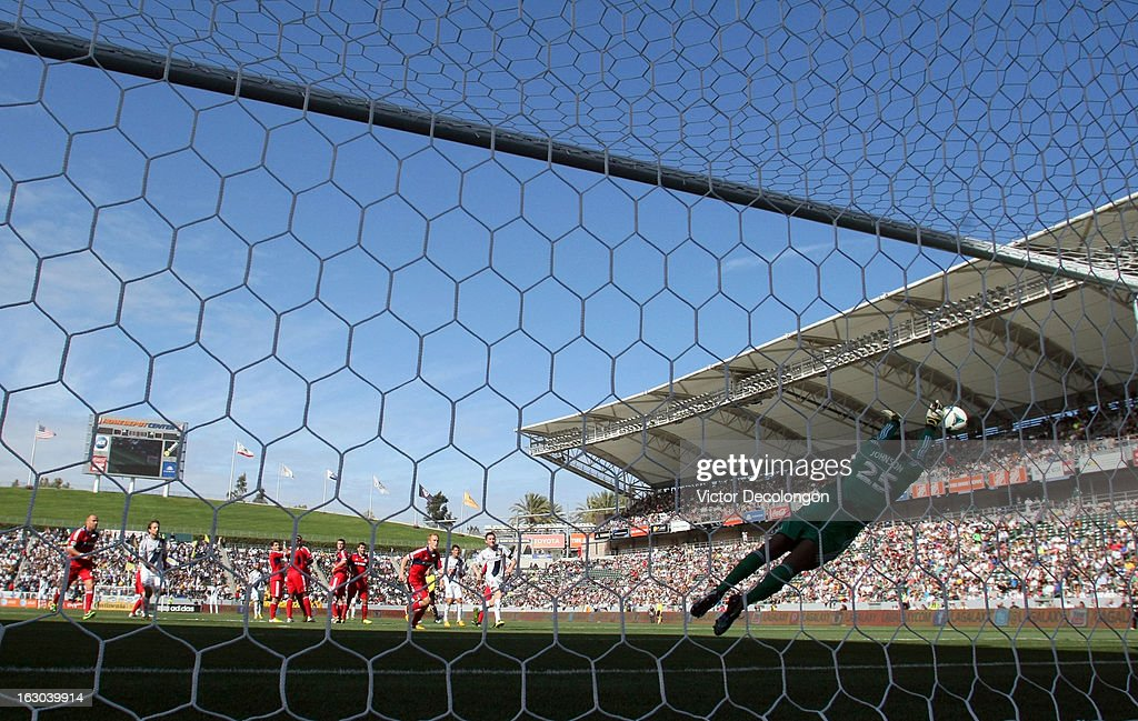 Goalkeeper Sean Johnson #25 of the Chicago Fire pushes the ball wide for a save during a direct free kick in their MLS match against the Los Angeles Galaxy at The Home Depot Center on March 3, 2013 in Carson, California. The Galaxy defeated the Fire 4-0.
