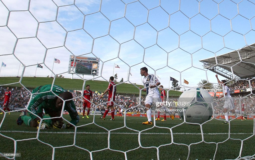 Goalkeeper Sean Johnson #25 of the Chicago Fire watches the ball in the net as Colin Clark #11 and Todd Dunivant #2 of the Los Angeles Galaxy react to the goal by teammate Mike Magee #18 (not in photo) during the MLS match at The Home Depot Center on March 3, 2013 in Carson, California. The Galaxy defeated the Fire 4-0.