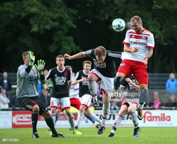 Goalkeeper Sebastian Lauridsen of Rotenburg and Oliver Dittmer of Rotenburg and PierreMichel Lasogga of Hamburg battle for the ball during the...