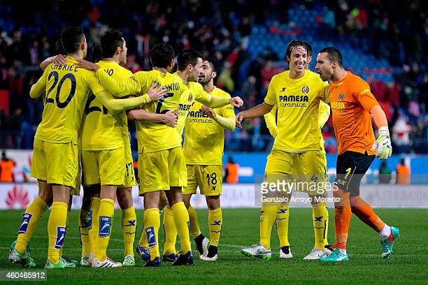 Goalkeeper Sergio Asenjo of Villarreal CF celebrates their victory with teammates after the La Liga match between Club Atletico de Madrid and...