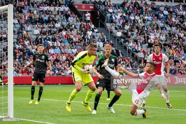 goalkeeper Sergio Padt of FC Groningen Kasper Larsen of FC Groningen Klaas Jan Huntelaar of Ajax Justin Kluivert of Ajax during the Dutch Eredivisie...