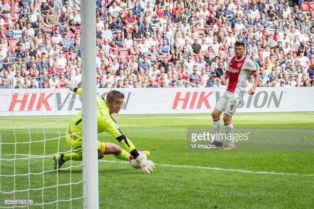 goalkeeper Sergio Padt of FC Groningen Klaas Jan Huntelaar of Ajax during the Dutch Eredivisie match between Ajax Amsterdam and FC Groningen at the...