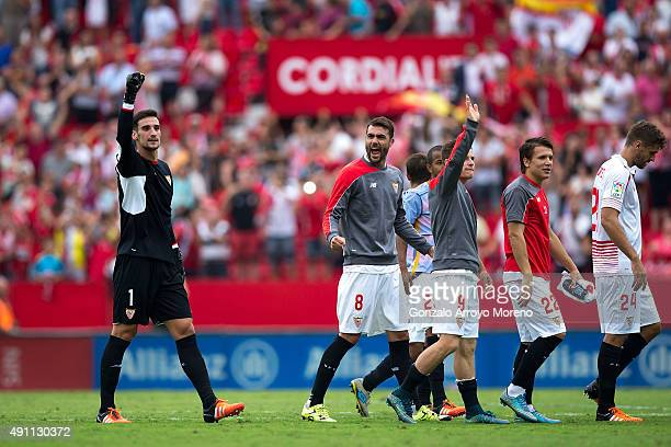 Goalkeeper Sergio Rico of Sevilla FC celbrates with teammates Vicente Iborra Kevin Gameiro Yevhen Konoplyanka and Fernando Llorente their victiry...