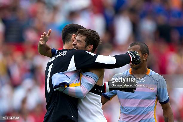 Goalkeeper Sergio Rico of Sevilla FC embraces his teammate Jorge Andujar Moreno alias Coke after winning the La Liga match between Sevilla FC and FC...