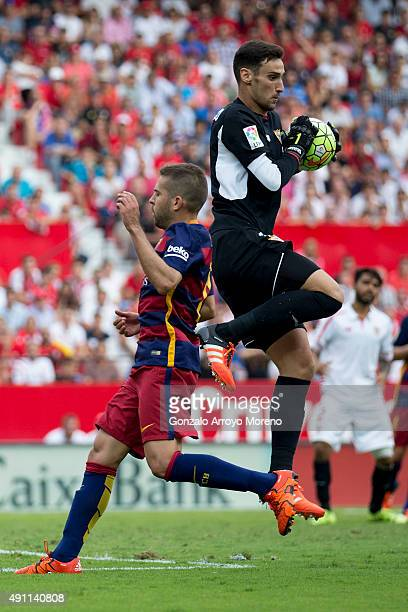Goalkeeper Sergio Rico of Sevilla FC stops the ball astriked by Jordi Alba of FC Barcelona during the La Liga match between Sevilla FC and FC...