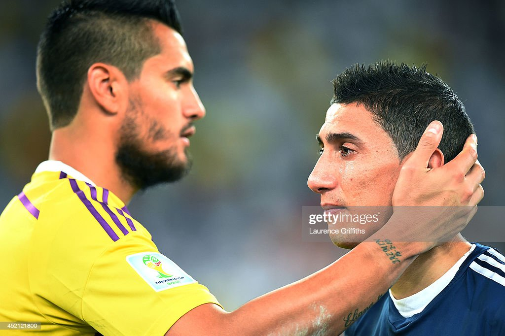 Goalkeeper Sergio Romero of Argentina consoles teammate Angel di Maria after being defeated by Germany 1-0 in extra time during the 2014 FIFA World Cup Brazil Final match between Germany and Argentina at Maracana on July 13, 2014 in Rio de Janeiro, Brazil.