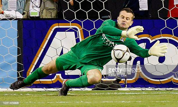 Goalkeeper Shay Given of Manchester City saves a penalty kick by Daniel Montenegro of Club America during the 2010 Aaron's International Soccer...