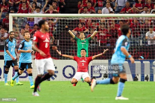 Goalkeeper Shusaku Nishikawa and Tomoaki Makino of Urawa Red Diamonds celebrate their 41 victory at the final whistle of the AFC Champions League...