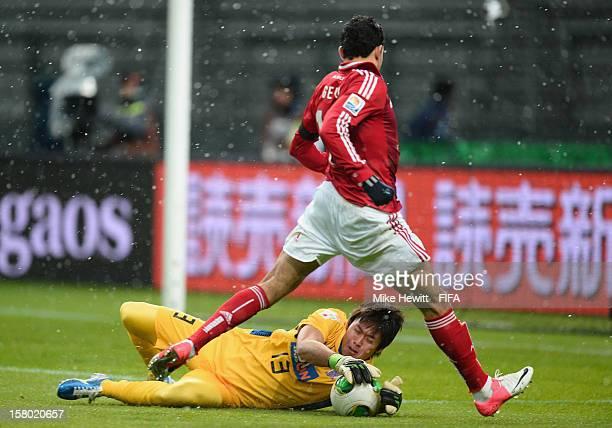 Goalkeeper Shusaku Nishikawa of Sanfrecce Hiroshima makes a fine save at the feet of Gedo of AlAhly during the FIFA Club World Cup Quarter Final...