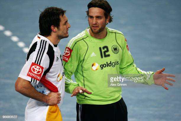 Goalkeeper Silvio Heinevetter of Germany discusses with team mate Michael Mueller during the international handball friendly match between Germany...