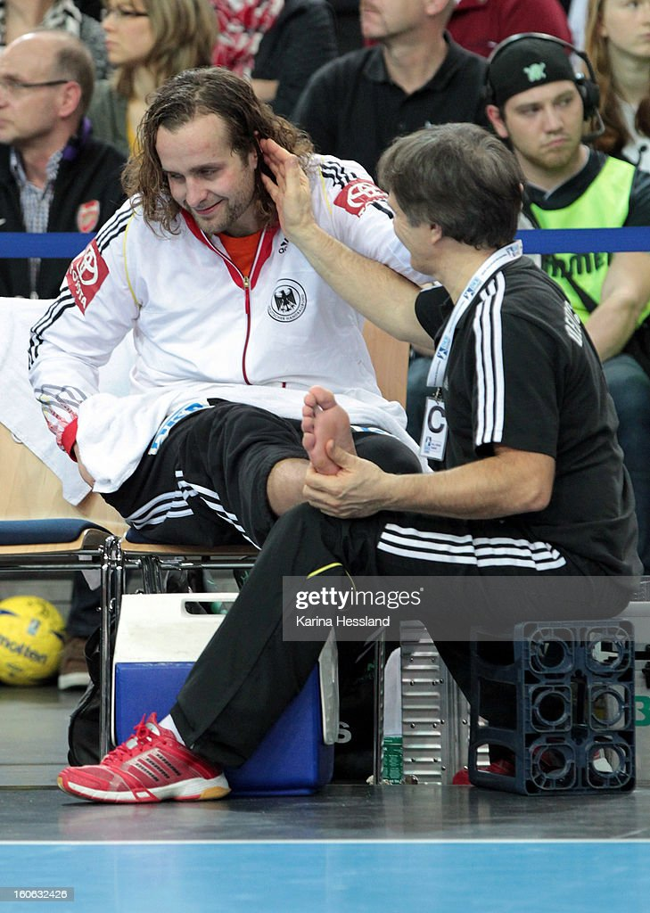 Goalkeeper Silvio Heinevetter of Germany with the physiotherapist during the match between Germany and Bundesliga All Stars on February 2, 2013 in Leipzig, Germany.