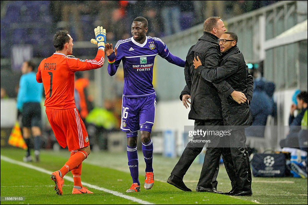 Goalkeeper Silvio Proto and Cheikhou Kouyate and coach John Van Den Brom of RSC Anderlecht celebrate a goal for their team during the UEFA Champions League Group C match between RSC Anderlecht and FC Zenit St Petersburg at the Constant Vanden Stock Stadium on November 6, 2012 in Brussels, Belgium.